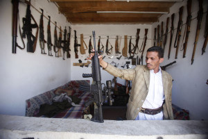 Arms dealer displays a rifle in his shop at an arms market in Jihana, around 30 km (19 miles) east of the Yemeni capital Sanaa